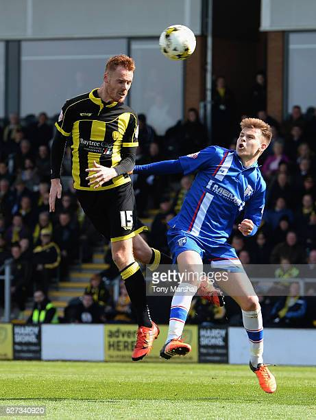 Tom Naylor of Burton Albion is tackled by Jake Hessenthaler of Gillingham during the Sky Bet League One match between Burton Albion and Gillingham at...