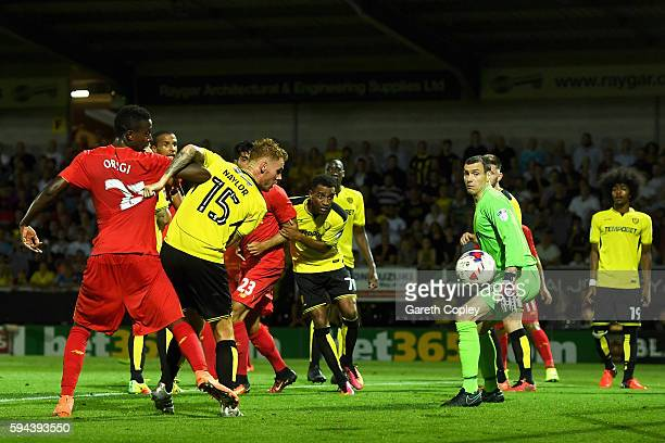 Tom Naylor of Burton Albion scores an own goal for Liverpool's third goal during the EFL Cup second round match between Burton Albion and Liverpool...