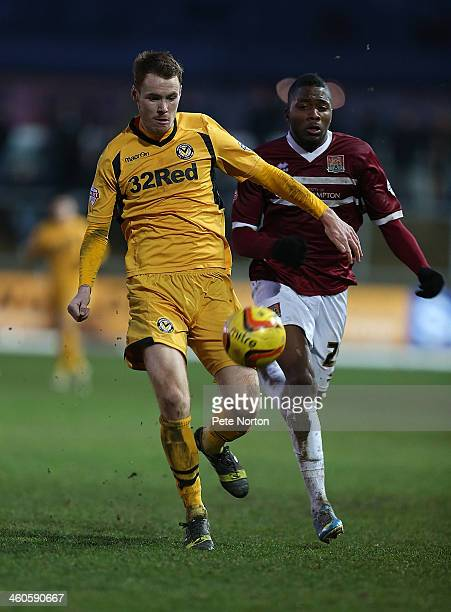 Tom Naylor of Newport County AFC looks for the ball with Antonio German of Northampton Town during the Sky Bet League Two match between Newport...