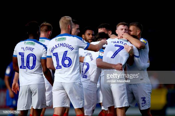 Tom Naylor of Portsmouth celebrates with his teammates after scoring his sides first goal during the Sky Bet League One match between AFC Wimbledon...