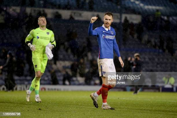 Tom Naylor of Portsmouth FC acknowledges the return of home fans during the Sky Bet League One match between Portsmouth and Peterborough United at...