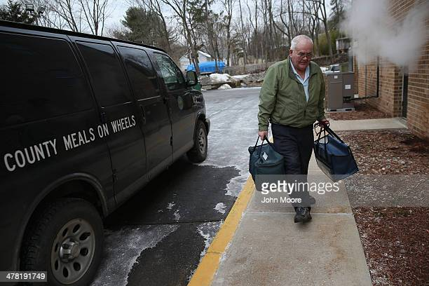 Tom Neville arrives to a nutrition center with a meals on wheels' food delivery for a dozen senior citizens on March 12 2014 in Newton New Jersey...