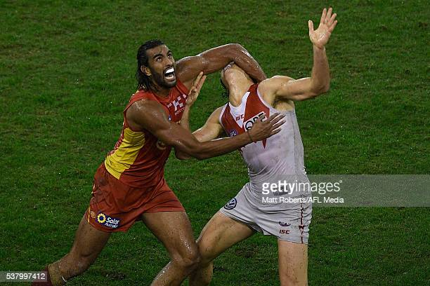 Tom Nicholls of the Suns competes for the ball against Kurt Tippett of the Swans during the round 11 AFL match between the Gold Coast Suns and the...