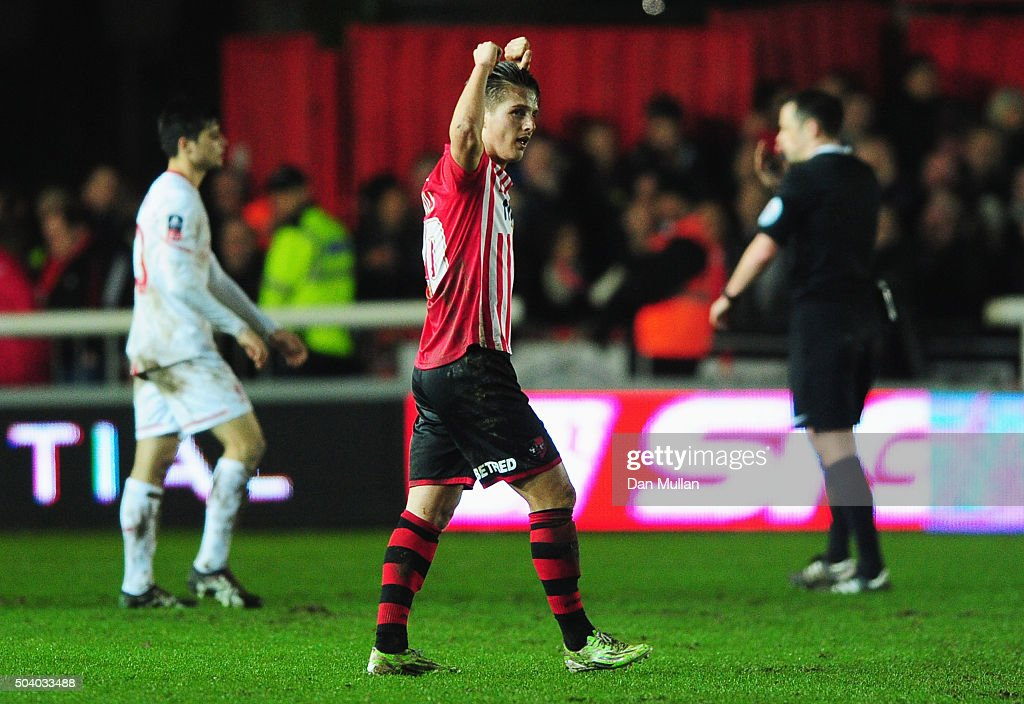 Tom Nichols of Exeter City celebrates the draw after the Emirates FA Cup third round match between Exeter City and Liverpool at St James Park on January 8, 2016 in Exeter, England.