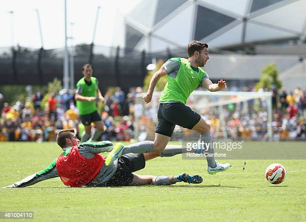 Tom Oar of Australia avoids a tackle from Terry Antonis during an Australian Socceroos training session at Collingwood training Ground on January 4...