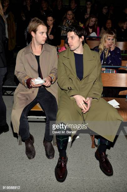 Tom Odell and James Bay wearing Burberry at the Burberry February 2018 show during London Fashion Week at Dimco Buildings on February 17 2018 in...