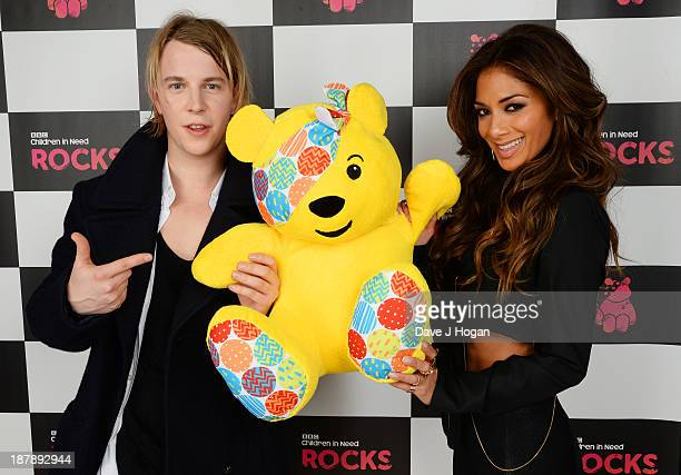 Tom Odell and Nicole Scherzinger pose with Pudsey Bear backstage during the 'BBC Children In Need Rocks' at Hammersmith Eventim on November 13 2013...
