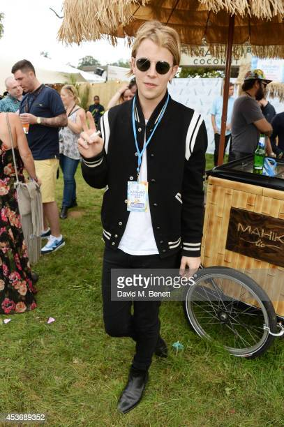 Tom Odell attends the Mahiki Rum Bar for the launch of the Mahiki Rum Family backstage during day 1 of the V Festival 2014 at Hylands Park on August...