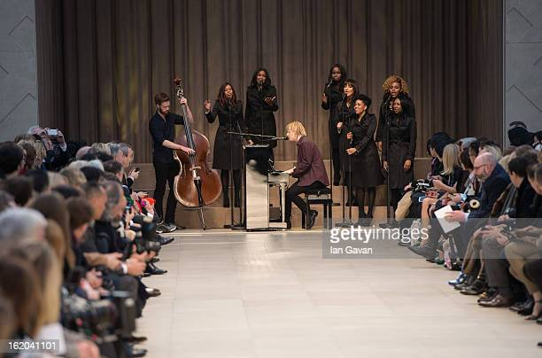 Tom Odell performs at the end of the runway during the Burberry Prorsum show during London Fashion Week Fall/Winter 2013/14 at Kensington Gardens on...