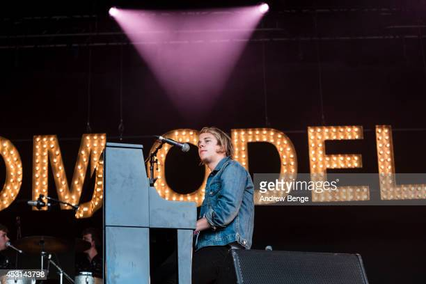 Tom Odell performs on stage at Kendal Calling Festival at Lowther Deer Park on August 3 2014 in Kendal United Kingdom