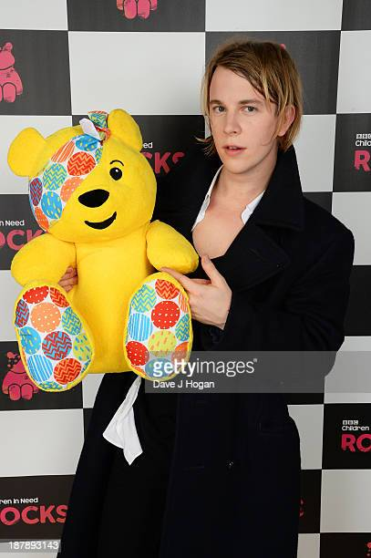 Tom Odell poses with Pudsey Bear backstage during the 'BBC Children In Need Rocks' at Hammersmith Eventim on November 13 2013 in London England BBC...