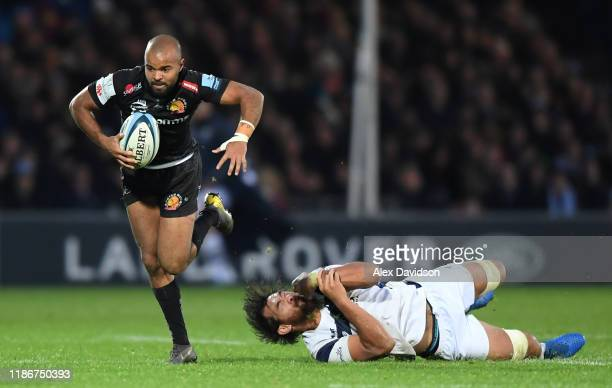 Tom O'Flaherty of Exeter Chiefs avoids the tackle of Steven Luatua of Bristol Bears during the Gallagher Premiership Rugby match between Exeter...