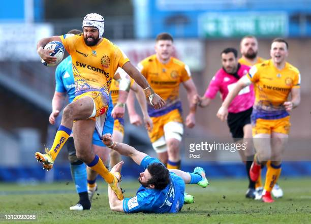 Tom O'Flaherty of Exeter Chiefs breaks through a tackle from Robbie Henshaw of Leinster during the Heineken Champions Cup Quarter Final match between...