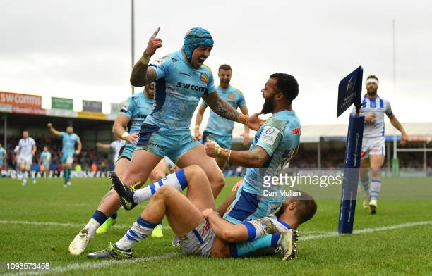 Tom O'Flaherty of Exeter Chiefs celebrates with his team mates after scoring his side's fourth and bonus point try during the Champions Cup match...