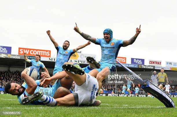 Tom O'Flaherty of Exeter Chiefs dives over to score his side's fourth and bonus point try during the Champions Cup match between Exeter Chiefs and...