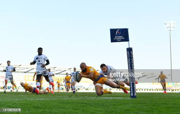 Tom O'Flaherty of Exeter Chiefs dives over to score his side's third try during the Heineken Champions Cup Round of 16 match between Exeter Chiefs...