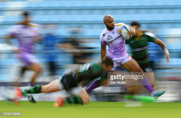 Tom O'Flaherty of Exeter Chiefs is tackled by Fraser Dingwall of Northampton Saints during the Heineken Champions Cup Quarter Final match between...