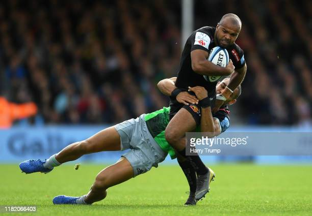 Tom O'Flaherty of Exeter Chiefs is tackled by Joe Marchant of Harlequins during the Gallagher Premiership Rugby match between Exeter Chiefs and...