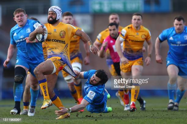 Tom O'Flaherty of Exeter is held up by Robbie Henshaw of Leinster during the Heineken Champions Cup Quarter Final match between Exeter Chiefs and...