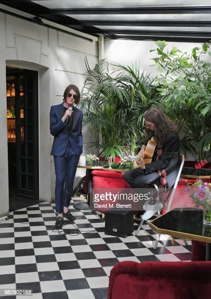 Tom Ogden and Josh Dewhurst of Blossoms perform at the Paul Smith SS19 VIP dinner during Paris Fashion Week at Hotel Particulier Montmartre on June...
