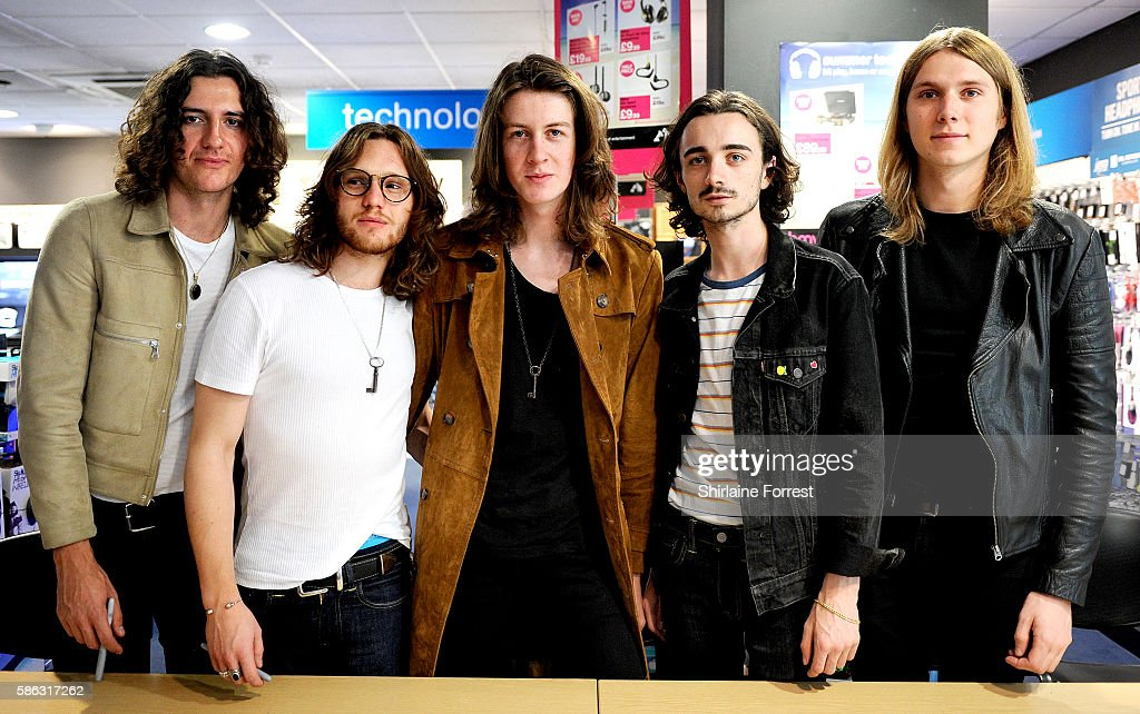 Tom Ogden, Charlie Salt, Josh Dewhurst, Joe Donovan and Myles Kellock of Blossoms perform a live acoustic set and sign copies of their debut album 'Blossoms' at HMV in their hometown of Stockport on August 5, 2016 in Stockport, England.