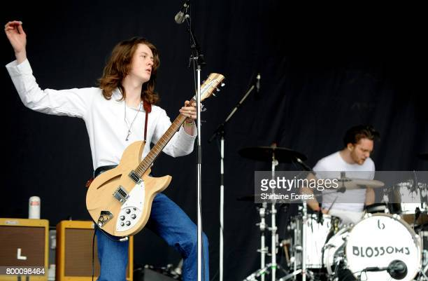 Tom Ogden of Blossoms performs on The Pyramid stage on day 2 of the Glastonbury Festival 2017 at Worthy Farm Pilton on June 23 2017 in Glastonbury...
