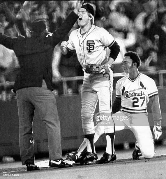 Tom O'Malley of the San Francisco Giants disagrees with the safe call from umpire Fred Brocklander as Lonnie Smith of the St. Louis Cardinals...