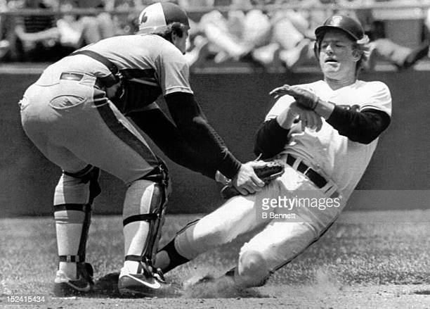 Tom O'Malley of the San Francisco Giants is tagged out at home by catcher Gary Carter of the Montreal Expos on June 4, 1983 at Candlestick Park in...