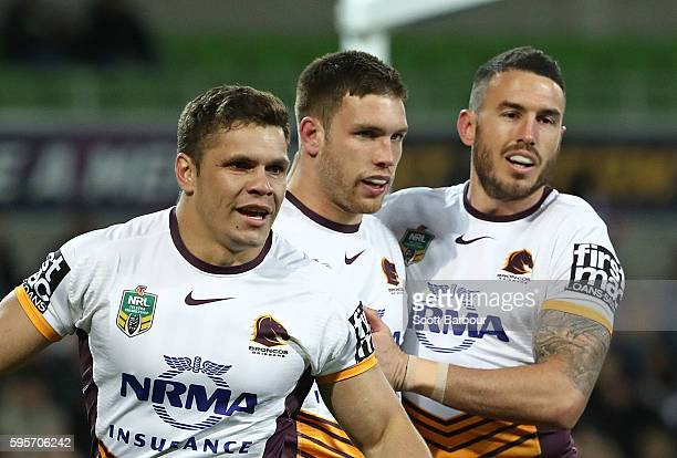 Tom Opacic of the Broncos is congratulated by Darius Boyd after scoring a try during the round 25 NRL match between the Melbourne Storm and the...