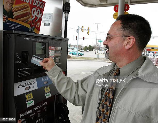 Tom Orchell uses his credit card to pay for his gas purchase at a Speedway gas station March 30 2005 in Des Plaines Illinois The average price of a...