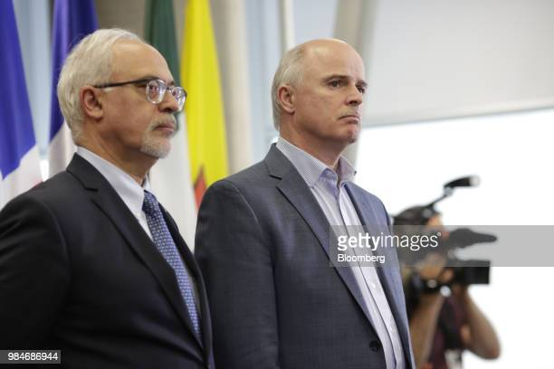 Tom Osborne Newfoundland and Labrador's finance minister right and Carlos Leito Quebec's finance minister listen during a press conference following...