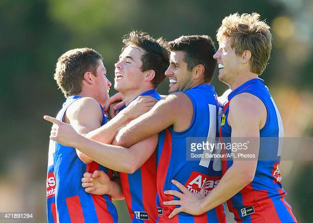 Tom O'Sullivan of Port Melbourne celebrates with his teammates after kicking a goal during the round three VFL match between Port Melbourne and...