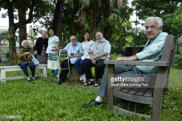 Tom Ovenstone 83yearsold and Peter Malpas 85yearsold picture in China Coast Community Home Kowloon Tong 01October2004 Staff and residents of Hong...