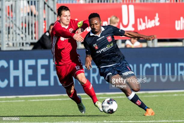 Tom Overtoom of Almere City FC Kelechi Nwakali of MVV Maastricht during the Dutch Jupiler League playoffs match between Almere City and MVV...