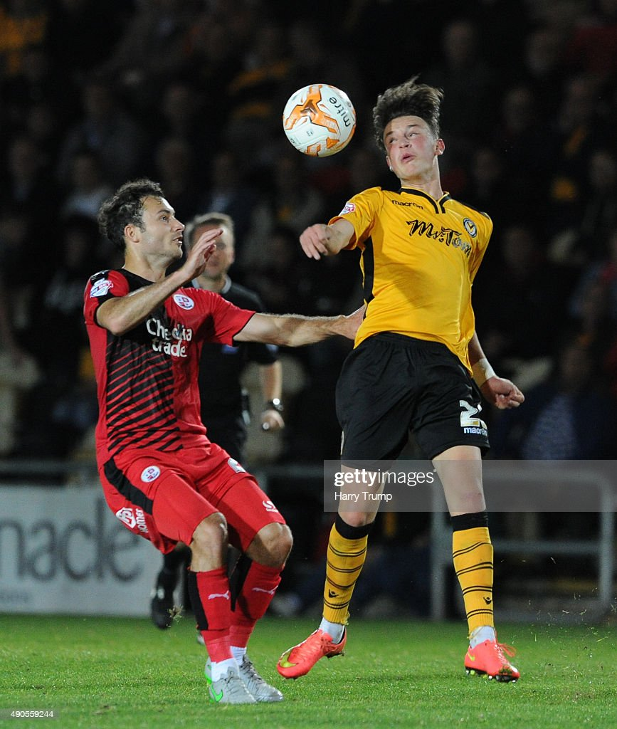 Tom Owen-Evans of Newport County challenges for the high ball with Ross Jenkins of Crawley Town during the Sky Bet League Two match between Newport County and Crawley Town at Rodney Parade on September 29, 2015 in Newport, Wales.