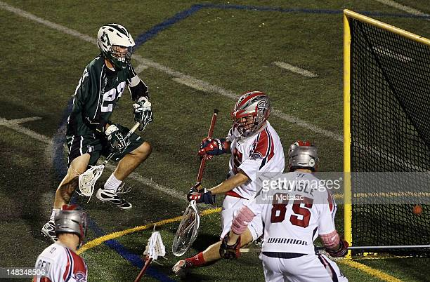 Tom Palasek of the Long Island Lizards scores a goal against Jordan Burke of the Boston Cannons during their Major League Lacrosse game on July 14...
