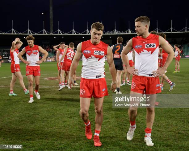 Tom Papley of the Swans and Jake Lloyd of the Swans looks dejected after a loss during the 2021 AFL Second Elimination Final match between the Sydney...