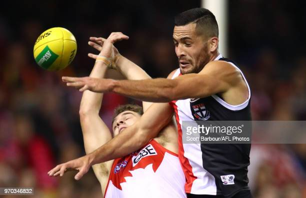 Tom Papley of the Swans and Shane Savage of the Saints compete for the ball during the round 12 AFL match between the St Kilda Saints and the Sydney...