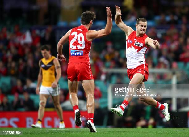 Tom Papley of the Swans celebrates kicking a goal the round 14 AFL match between the Sydney Swans and the Hawthorn Hawks at Sydney Cricket Ground on...