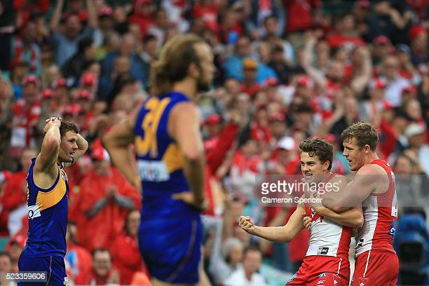 Tom Papley of the Swans celebrates with team mate Luke Parker after kicking a goal during the round five AFL match between the Sydney Swans and the...