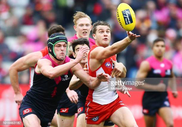 Tom Papley of the Swans competes for the ball against Angus Brayshaw of the Demons during the round 21 AFL match between the Melbourne Demons and the...