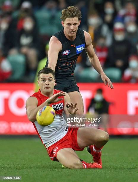 Tom Papley of the Swans gathers the ball infront of Lachie Whitfield of the Giants during the AFL Second Elimination Final match between the Sydney...