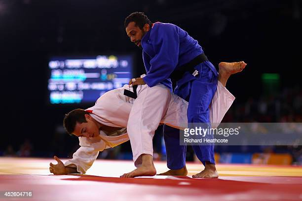 Tom Pappas of Australia is beaten by Navjot Chana of India in the Men's Judo 60kg at SECC Precinct during day one of the Glasgow 2014 Commonwealth...