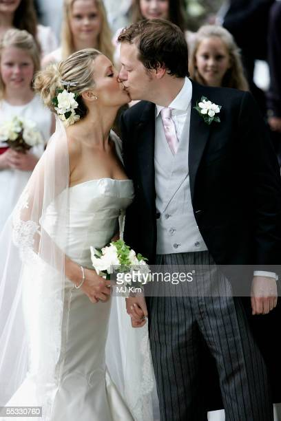 Tom Parker Bowles kisses his new wife Sara as they leave their ceremony in St Nicholas Church HenleyonThames on September 10 2005 in Oxfordshire...