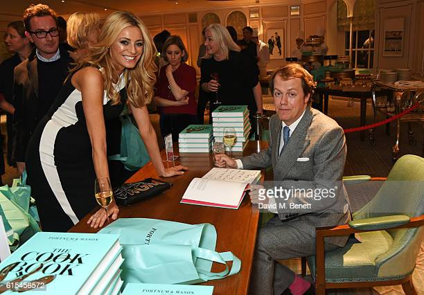 "Tom Parker Bowles signs a book for Tess Daly at the launch of ""Fortnum & Mason: The Cook Book"" by Tom Parker Bowles at Fortnum & Mason on October 18,..."