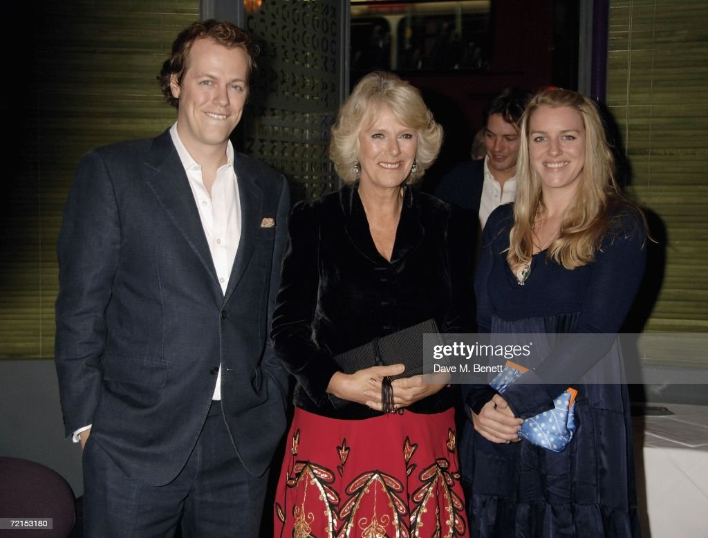 Tom Parker Bowles with his mother Camilla, Duchess of Cornwall and Laura Parker Bowles (R) attend the book launch of 'The Year Of Eating Dangerously' by Tom Parker Bowles, at Kensington Place on October 12, 2006 in London, England.