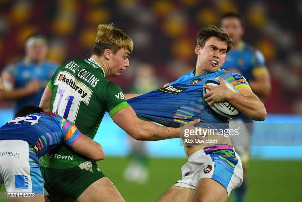 Tom Parton of London Irish dodges the contact of Ollie Hassell-Collins of London Irish during the Gallagher Premiership Rugby match between London...