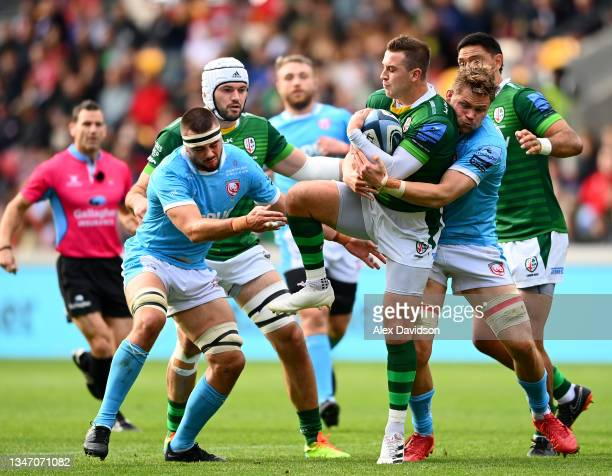 Tom Parton of London Irish is tackled by Lewis Ludlow and Freddie Clarke of Gloucester during the Gallagher Premiership Rugby match between London...