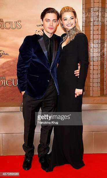 Tom Payne and Emma Rigby attend 'The Physician' German Premiere on December 16 2013 in Berlin Germany