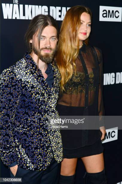 Tom Payne and Jennifer Akerman arrives at the Premiere Of AMC's 'The Walking Dead' Season 9 at the DGA Theater on September 27 2018 in Los Angeles...